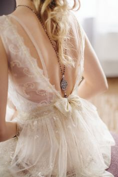 ...necklace on the back and delicate bride's dress...