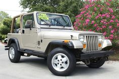 1993 Tan YJ - Only 64k Miles, Automatic, Has a Hard Top, Super Clean!!! http://www.selectjeeps.com/inventory/view/7679854?1993+Jeep+Wrangler+2dr+Base+League+City+TX