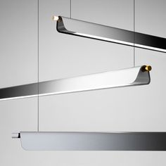 Note Design Studio of Stockholm were inspired by a circus trapeze to create these pendent lamps with aluminium shades that appear to be draped over a wooden pole.