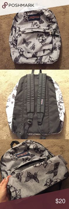Grey butterfly Jansport school/leisure backpack Grey and black butterflies JanSport backpack. Used but in a great condition, feels like new! Jansport Bags Backpacks