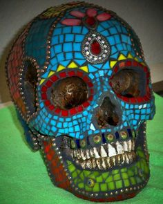 this is my idea for my Halloween design this year, a Day of the Dead egg shell mosaic.