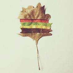 """A piece of burger-inspired art by artist Brock Davis: """"this fell off the cheeseburger tree today."""""""