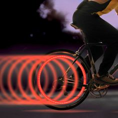 This image gives us a great light painting affect with the use of the bicycle wheels. Lights have been placed on the back bicycle wheel and while the bike was moving, the camera captured this affect. Bicycle Spokes, Bicycle Safety, Bicycle Wheel, Bicycle Art, Velo Design, Bicycle Lights, Bike Light, Lampe Led, Red Led