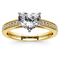 Wear the promise of forever with this Heart-cut Pave Cathedral Diamond Ring in Yellow Gold featuring twenty-four pave-set round cut diamonds, and one beautiful center. By http://www.brilliance.com #wedding #engagement #diamond #ring #jewelry
