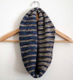 Can make this. Knit in the round, so it's thicker. Alternate the colors. Sew together at end to make it an infinity scarf.