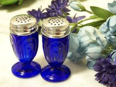 """Blue Glass Salt & Pepper Set by iwdsc. $18.99. Great Gift Idea.. Manufactured to the Highest Quality Available.. Design is stylish and innovative. Satisfaction Ensured.. 3 1/2"""" tall cobalt blue glass salt and pepper set. Previous number 36-13073b"""