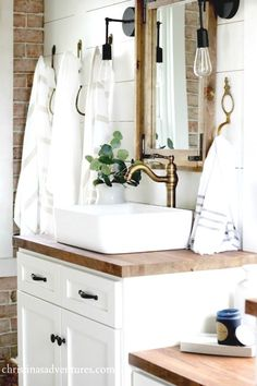 Vintage Inspired Farmhouse Bathroom Makeover Vintage inspired farmhouse bathroom – lots of shiplap, white, wood tones, and mixed metals. You won't believe what it looked like before! Rustic Master Bathroom, Bathroom Vanity Decor, White Vanity Bathroom, Bathroom Styling, Bathroom Ideas, Bathroom Remodeling, Bathroom Mirrors, Bathroom Lighting, Gold Bathroom