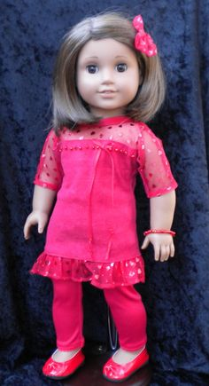 Sandy was trying to decide what to wear to school, when our resident fashionista, Ruthie helped her get her red together. This interesting faux polyester suede and heart-printed tulle tunic is made from a great pattern by QTπ Doll Clothing. The tunic, that could easily double as a dress, has a full back opening and velcro closure. The purchased tights are polyester with an elastic waist. The accessories that the girls chose include a bracelet made of beads to match the embellishment on the…