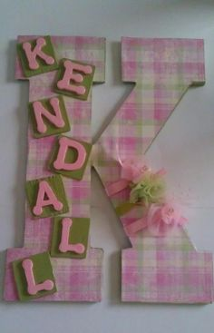 DYI - used scrapbook paper from Hobby Lobby, letters,coordinating ribbon and flowers..cute for a baby room