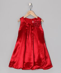 A bouncy bubble silhouette gives this silky satin dress an extra heap of poufiness, while its back tie and zipper fasten faster than a fairy can flap her wings. Plus, the pretty flower pin can be easily plucked from this gorgeous garden of a gown for washing.Includes dress and pin100% polyesterHand wash...