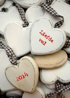 Liefdevol Nieuwjaar - 2014 op houten hartjes