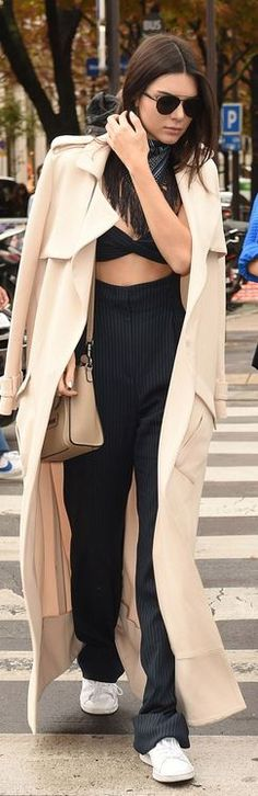 Kendall Jenner: Sunglasses – Dior  Jumpsuit – Alessandra Rich  Shoes – Kenneth Cole  Purse – Celine