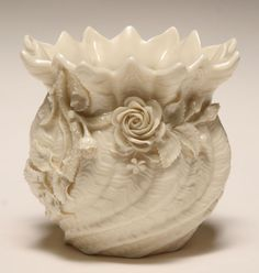 Irish Belleek Porcelain.Belleek Porcelain was first made in County,Fermanagh, Ireland in the year of 1857. It is a thin and ivory-colored, iridescent porcelain in many different shapes and patterns.