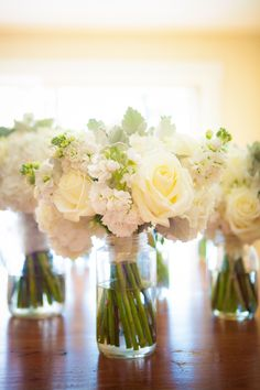 White bouquets at Snow Moon Ranch in Maple City, Michigan. Hitching Post Photography. More Bouquets http://www.theknot.com/weddings/photos/bridal-bouquets