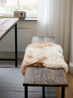 Table with bench + sheep skins