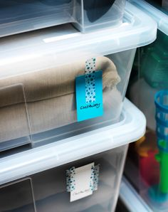 A close up of some paper labels on some see-through storage boxes. Moving And Storage, Small Storage, Storage Boxes, Storage Organization, Ikea Samla, Ikea Boxes, Ikea Ideas, Organising, Transparent