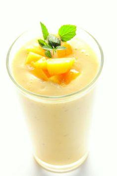 Peach Smoothie-2 ripe peaches peeled and slice 1 banana 1 C. yogurt 1 t. honey 1 t. vanilla rum or vanilla 1 handful of ice cubes