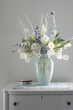 Karin Lidbeck: Styling a Winter White Floral Arrangement for Good Housekeeping  Interesting how she paints the inside of the vase