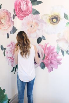 This year is all about the watercolor accents and these oversized floral wall decals bring the trend straight into your nursery. Details + Dimensions: - Includes nine individual flowers + leaves - Flo
