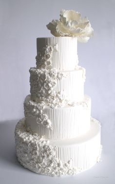 White Bas-relief wedding cake with sugar poppies