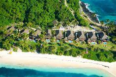 Among the best Fiji's Resorts for Honeymoons, Matamanoa Island Resort. Aerial shot of their new Beachfront Villas