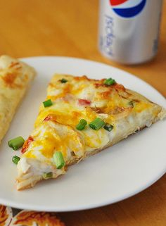Chicken Ranch Pizza--ohhhhhh yum. Ranch dressing, garlic, mozz., cheddar, & parmesan cheese, chicken, romas & green onions.