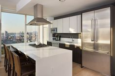 Contemporary Kitchen with Kitchen island, Onyx counters, Simple Marble, flush light, One-wall, Laminate floors, Breakfast bar