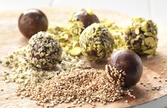 Glutenfree and raw truffle balls, with chocolate, dates and different kinds of seeds and nuts.