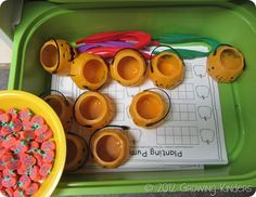 There are numbers 1-10 written on the pumpkins. The kids use the tweezers to put the pumpkin erasers into the correct pumpkin cup. They then write the number on the pumpkin and fill in the ten frame. They are really enjoying this one!