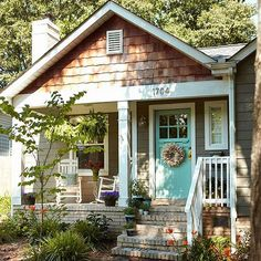 Go Whimsical in Your Color Approach. Teal front door and gray grey exterior on house home. (IDEA for front porch)
