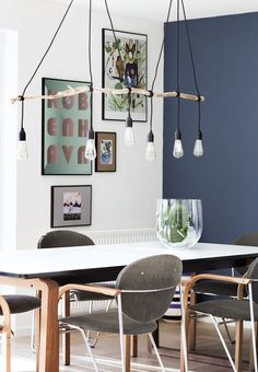 Make your own DIY lamp to hang over the dining table. It requires just a nice branch from nature, where the bark is removed, and some sockets with fabric cable. Twist the fabric cables around the branch and voila!