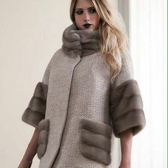 A very hip coat in the color of off-white with a fur cowl neck, length sleeves with sprayer attached at the bottom half. A very hip luxurious look. Fur Fashion, Trendy Fashion, Winter Fashion, Fashion Dresses, Womens Fashion, Fashion Trends, Elisa Cavaletti, Winter Fur Coats, Coats For Women