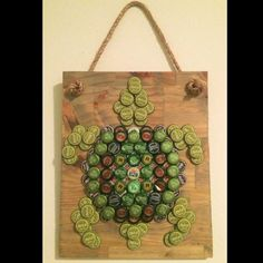 So obsessed with this Tipsy Turtle! And it was requested by a customer! Over 140 beer bottle caps were recycled to create this piece. Send me a message and I'll see if I can bring your ideas to fruition! Beer Bottle Crafts, Beer Cap Crafts, Bottle Cap Projects, Diy Bottle, Bottle Top Art, Beer Cap Art, Turtle Crafts, Diy Upcycling, Recycled Crafts