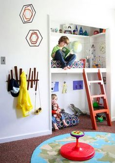 Closet reading nooks.  Neat way to use closets, and get two spaces for the girls.