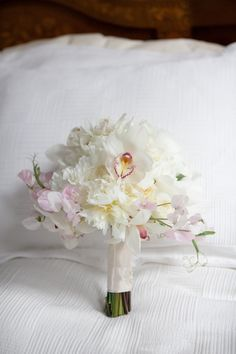 White orchid, peony, & sweet pea bridal bouquet floral design