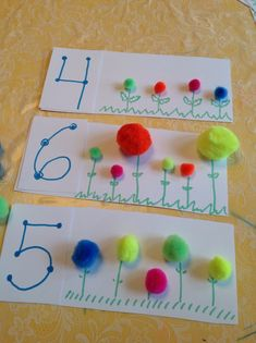 Use two colors of pom poms and this becomes a composing/decomposing numbers activity.