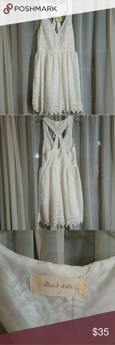 NWT Altar'd State Lace Dress NWT Altar'd State  white lace dress. Never worn! Altar'd State Dresses