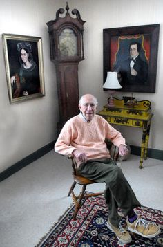 Peter Tillou will be presented the Antiques Dealers' Association of America's Award of Merit on Saturday, April 13, in conjunction with the Philadelphia Antiques Show. He is shown here amid some of his favorite things: a wonderful Ammi Phillips painting of a lady with lace cap and red shawl, a portrait of George Colby by H.K. Goodman, a boldly painted nightstand and a Connecticut tall case clock. —Antiques and The Arts Weekly, David S. Smith photo