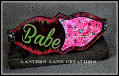 custom painted bronc noseband in hot pink, lime green