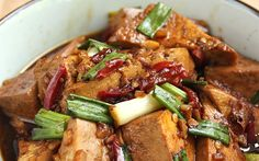 In this recipe, firm tofu is marinated in soy sauce, oil, garlic, sugar, and peppers and then pan-friend until golden brown.