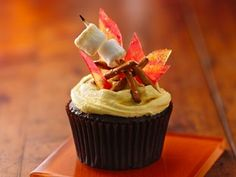 Campfire S'mores Cupcake- I say use strips of fruit rollups for the flame pretzel sticks and a oreo frosting and call it a day!-Definately doing this!