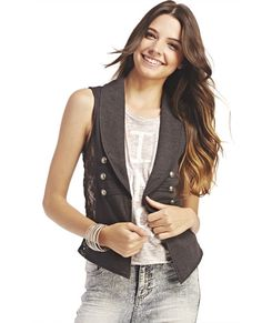 "<p>Dress up your look with this add-on piece, a French terry fleece vest designed with floral lace insets at each side, a blazer-like lapel and three metal button detail at the front. Vest is unlined and has a pointed longer front hem at each side of the open front.</p>  <p>Model is 5'9"" and wears size small.</p>  <ul> 	<li>Self: 60% Cotton / 40% Polyester</li> 	<li>Lace: 90% Nylon / 10% Spandex</li> 	<li>Hand Wash</li> 	<li>Imported</li> </ul>"