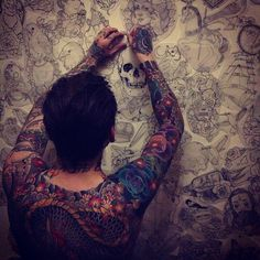 Inked. Men's. Tattoo. Wall. Of. Sketches.