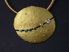 "Pendant | Kim Jones.  ""Commission- Where the planets were aligned when Nancy and Roger were married. 18K"""
