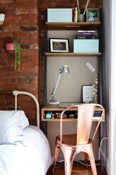 All-in-one desk/bookshelf/nightstand snug in this bedside nook!