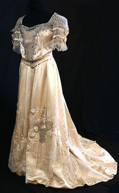 Dumay jeweled satin ballgown, c.1900 What a brilliant high-style French ballgown. Here, style certainly supersedes condition in couture-quality design from the House of Dumay. This is a triumph of Edwardian haute couture decoration in its literally most florid phase: the lifelike padded satin roses are a wonder to behold....