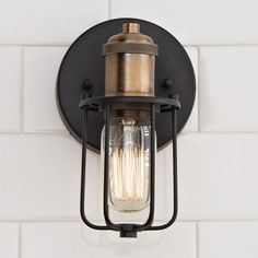 industrial bathroom This bold industrial look has lots of style with a warehouse-inspired cage shade in Matte Black and flashy Gold socket. The effect is elevated by the 360 degree adjustability of the lamps. Can be wall or ceiling mounted. Bathroom Sconces, Bathroom Light Fixtures, Bathroom Interior, Gold Bathroom, Charcoal Bathroom, Cream Bathroom, Shower Mirror, Bathroom Wall Lights, Glass Shower