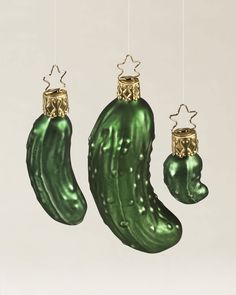 The Legend of the Pickle Blown Glass Ornament Set pays homage to the American custom of concealing a pickle-shaped ornament deep within the branches of the Christmas tree.