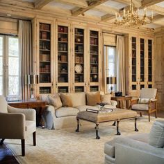 Love the pine box beamed ceiling and library cabinet doors to the ceiling