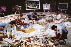 Imagineers hard at work on a model of the entire park